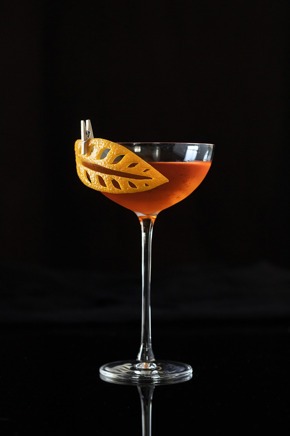 sunset strip cocktail with carved citrus peel garnish