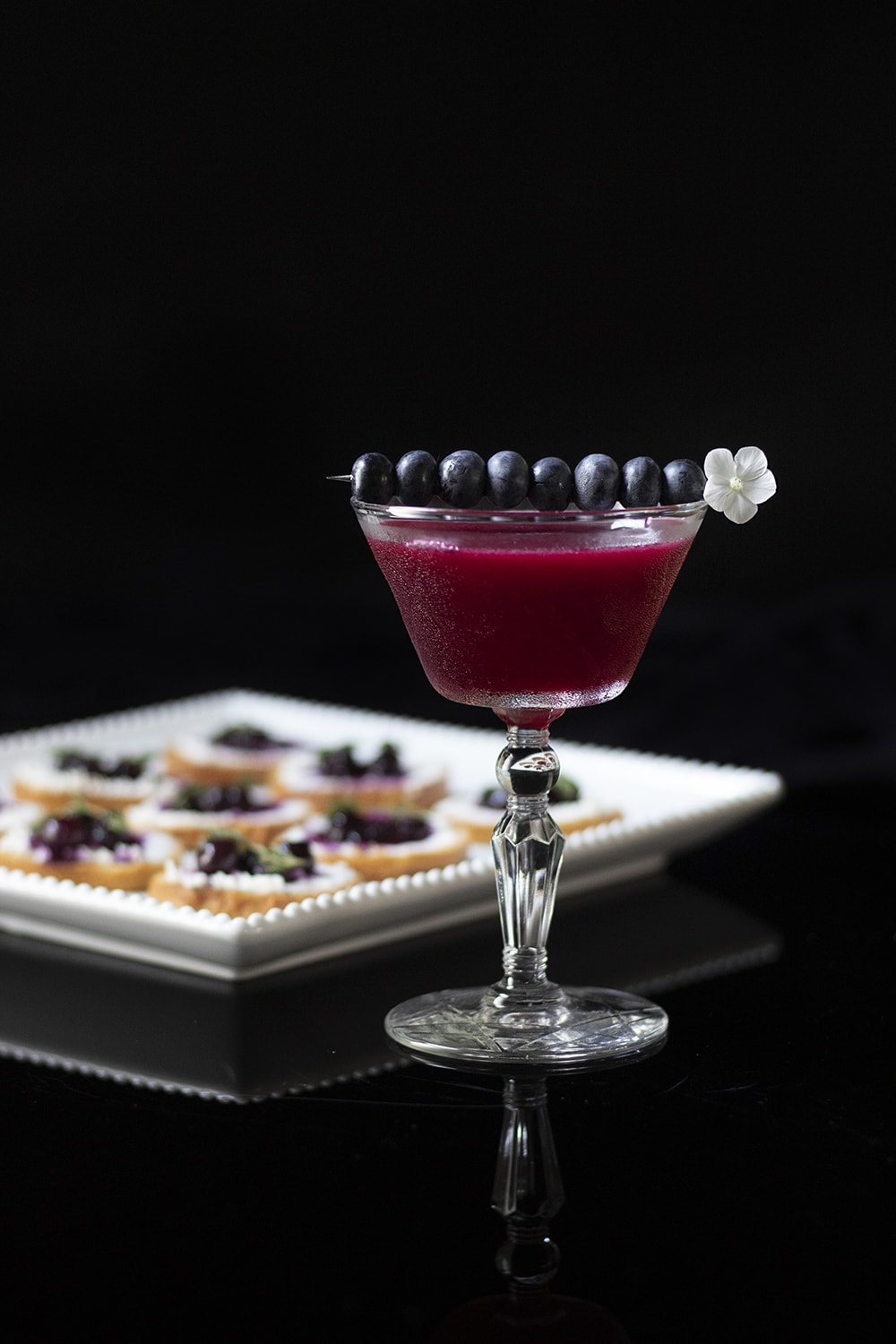 blueberry bourbon corpse reviver with bluberry thyme crostinis