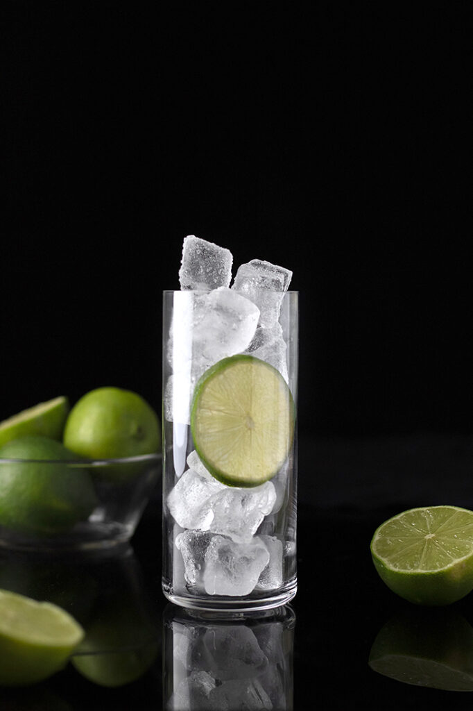 highball glass filled to the top with ice cubes