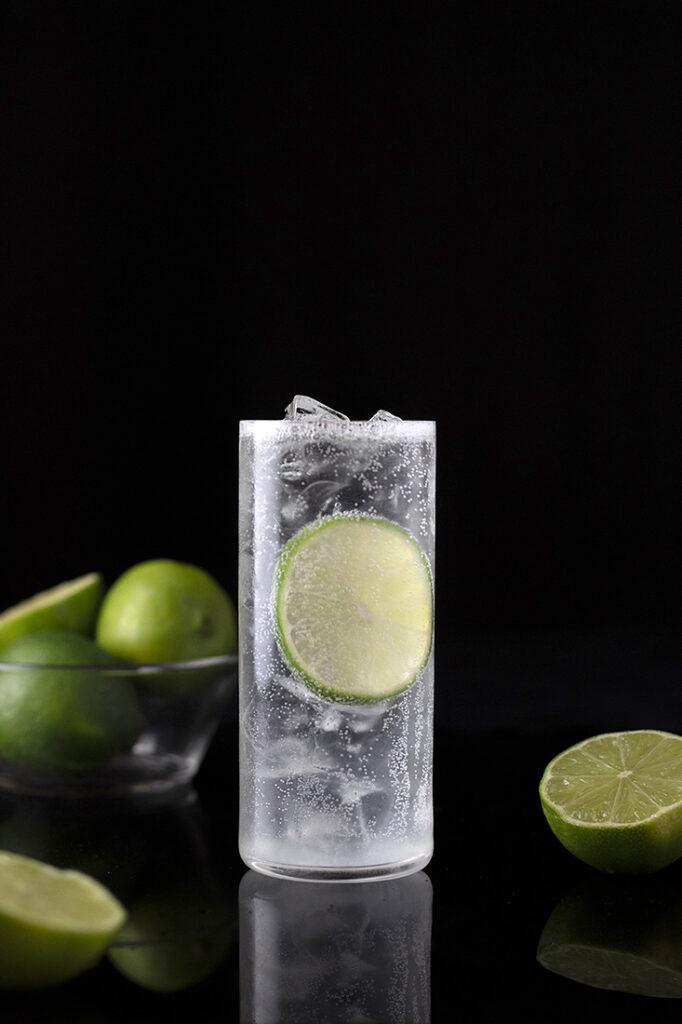 highball glass with limes