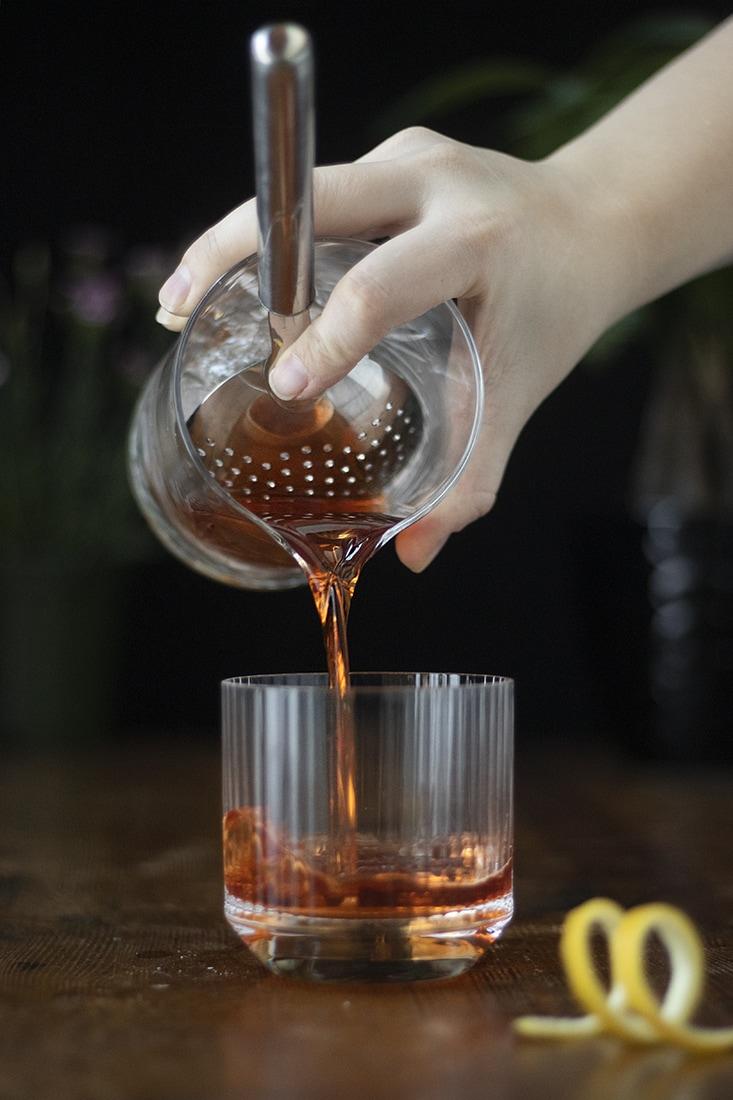 pouring-a-classic-sazerac-cocktail