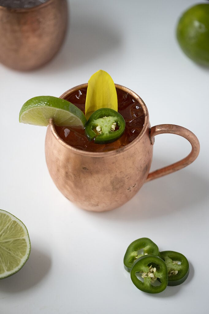 top down view of moscow mule mug with jalapeno and lime