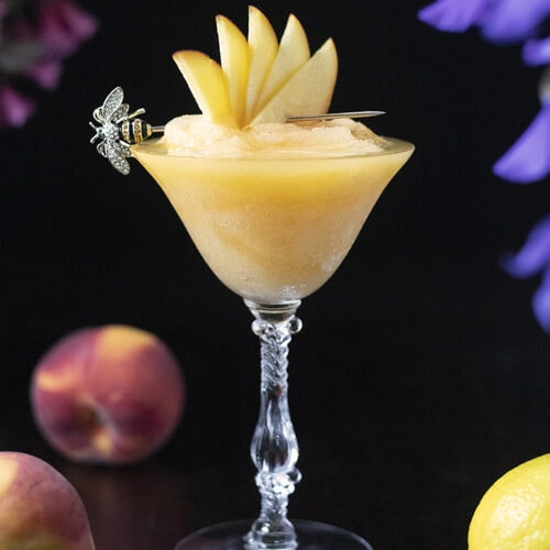 a frozen yellow cocktail in a vintage coupe glass