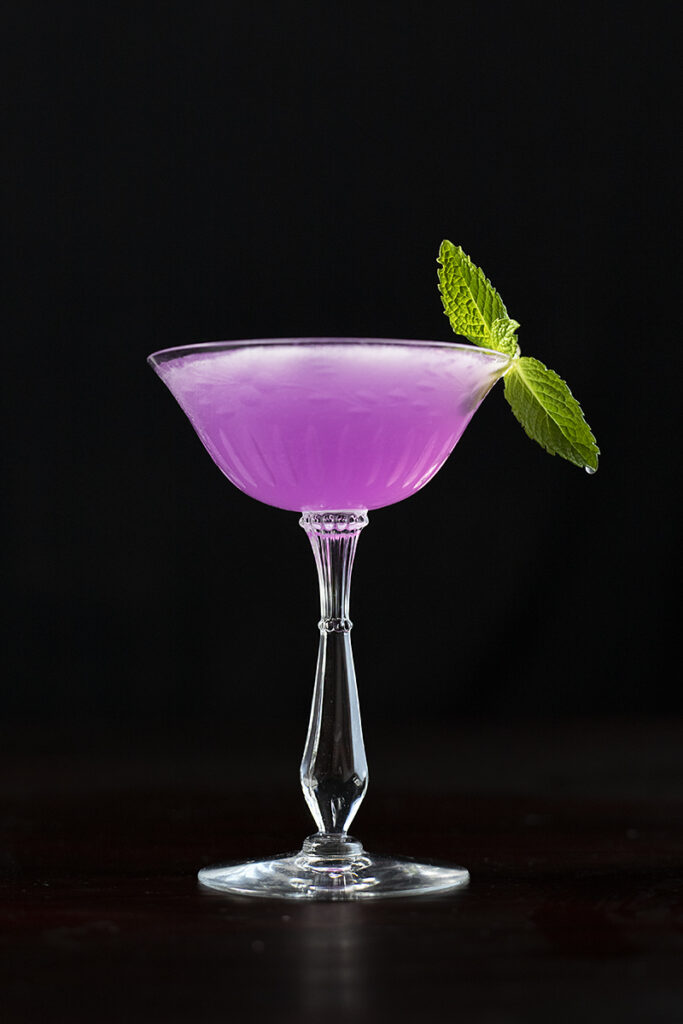 purple cocktail on a black background