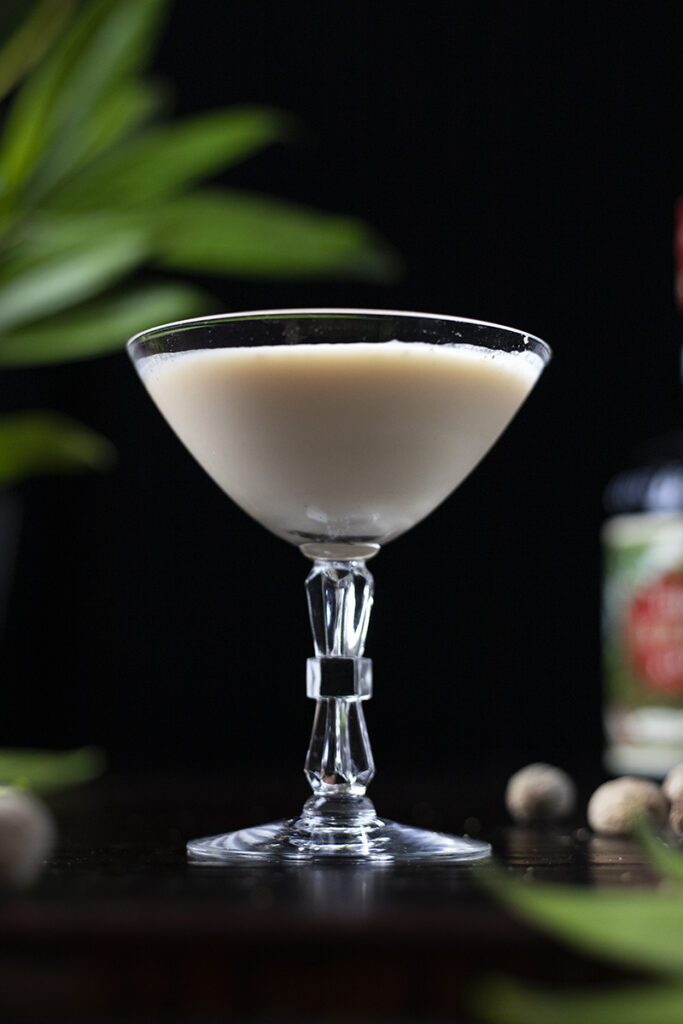 a tan colored creamy cocktail in a coupe glass