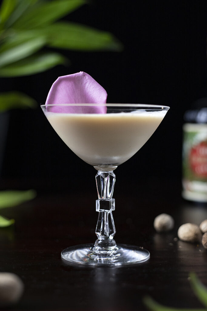 creamy tan cocktail in a coupe glass