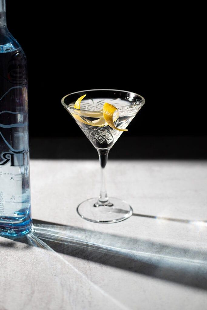 a martini with a lemon twist.