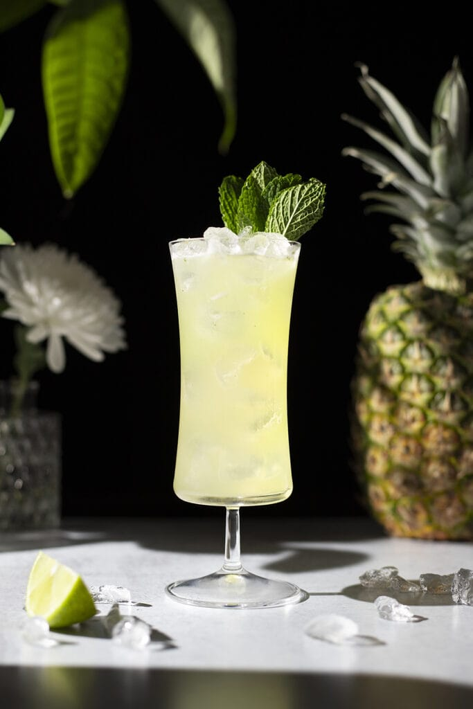 Missionary's Downfall cocktail garnished with mint leaves.