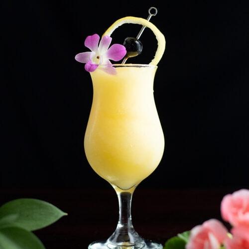 yellow frozen cocktail in a poco grande glass