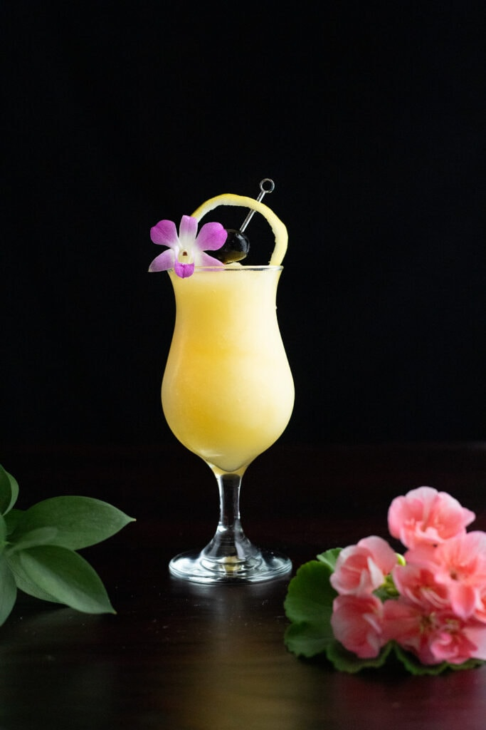 saturn cocktail with pink flowers.