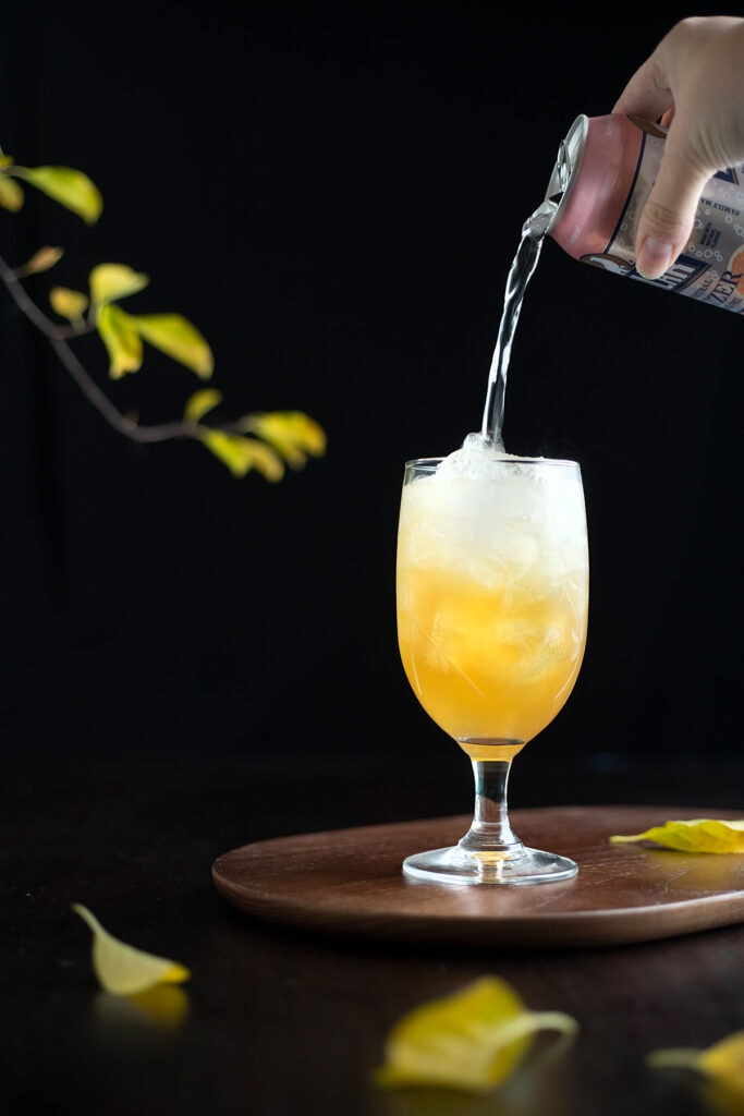 topping a cocktail with seltzer water