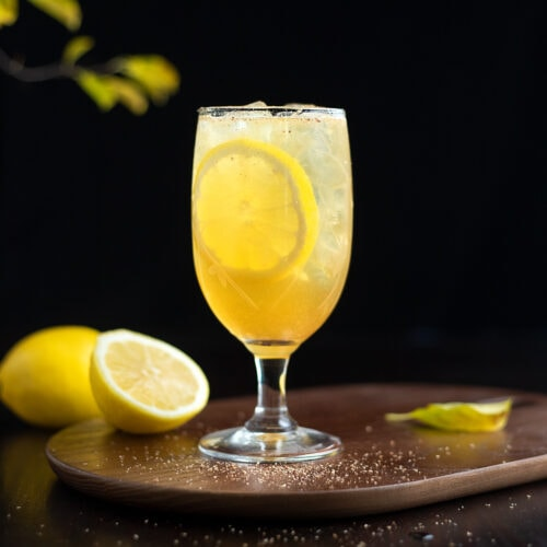 glass of punch with lemon wheels