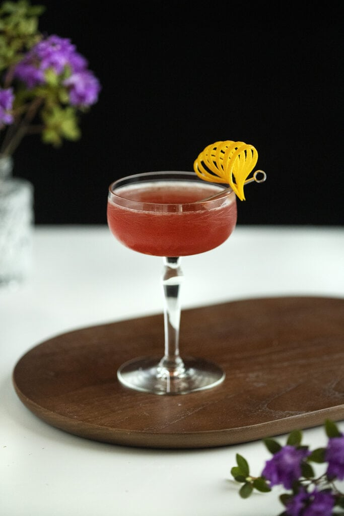 a scofflaw cocktail on a serving board.