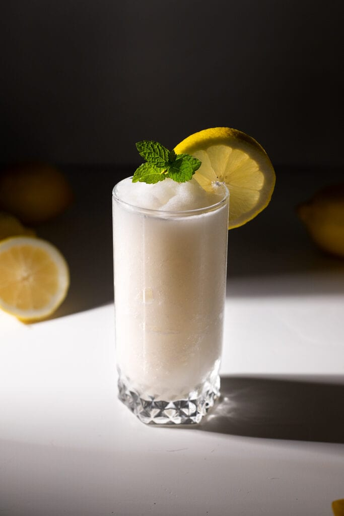 top down view of frozen whipped lemonade in a tall glass.