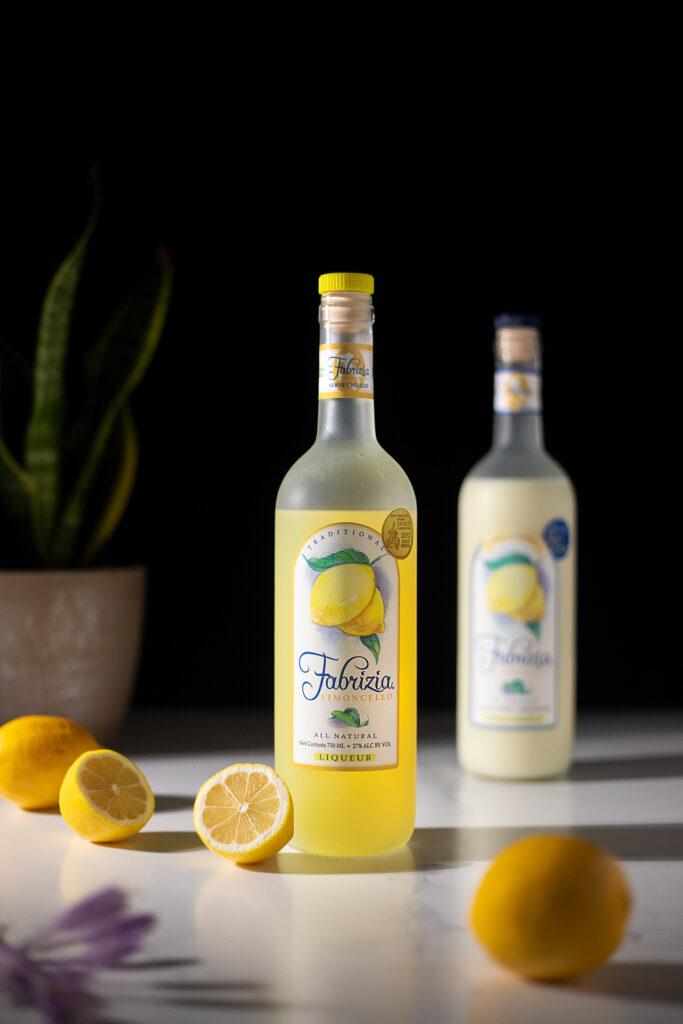 a bottle of Fabrizia Limoncello with lemons.