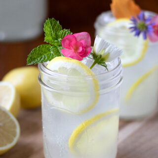 glasses of lemonade with mint and flowers.