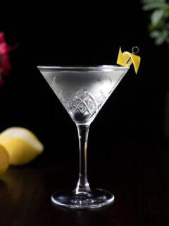 a martini garnished with a lemon twist.