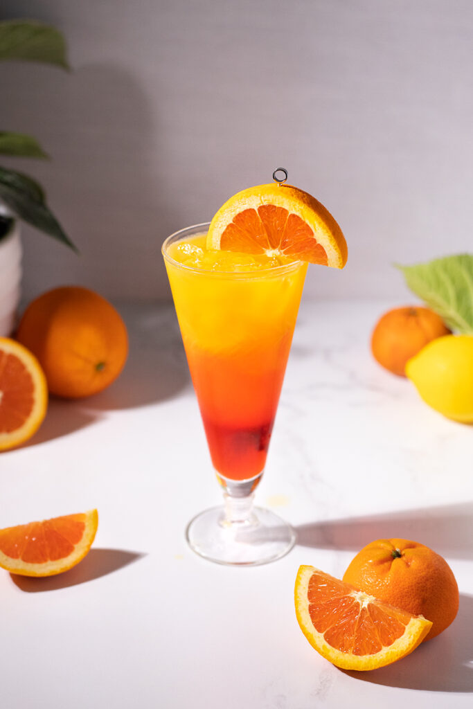 a tall drink with layers of red, orange, and yellow