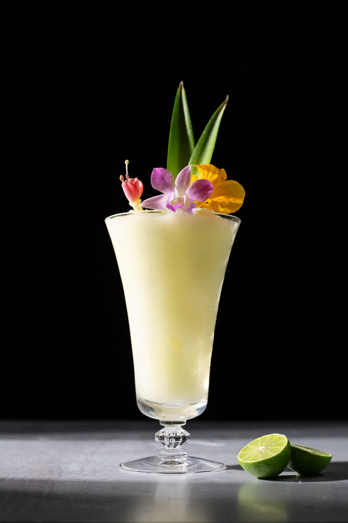 frozen blended white drink with edible flowers.