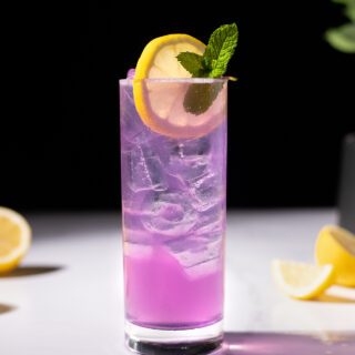 a purple drink in a Collins glass with a lemon wheel and mint.