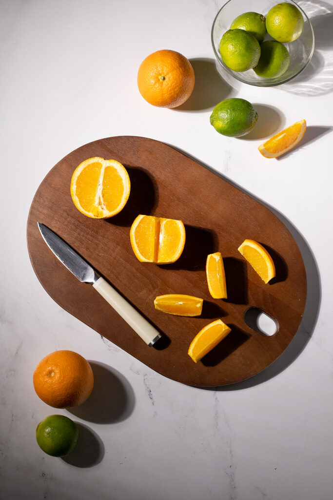 an orange cut into wedges.
